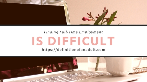 Finding Full-Time Employment Is Difficult – Background is a Laptop with Flowers and a Mug